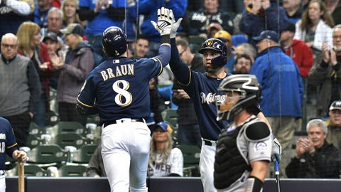 May 2, 2019; Milwaukee, WI, USA; Milwaukee Brewers leftfielder Ryan Braun (8) is congratulated by catcher Manny Pina (9) after hitting a home run against the Colorado Rockies in the fourth inning at Miller Park. Mandatory Credit: Michael McLoone-USA TODAY Sports