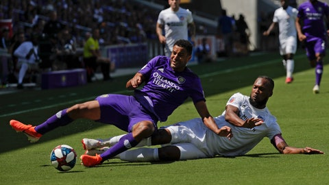 <p>               Orlando City's Tesho Akindele, left, and FC Cincinnati's Kendall Waston battle for possession of the ball during the first half of an MLS soccer match, Sunday, May 19, 2019, in Orlando, Fla. (AP Photo/John Raoux)             </p>