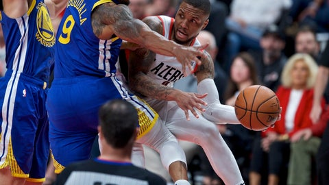 <p>               Portland Trail Blazers guard Damian Lillard, right, passes the ball away from Golden State Warriors guard Andre Iguodala, center, and guard Klay Thompson, left, during the first half of Game 3 of the NBA basketball playoffs Western Conference finals Saturday, May 18, 2019, in Portland, Ore. (AP Photo/Craig Mitchelldyer)             </p>