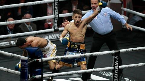 <p>               Naoye Inoue, right, of Japan, celebrates knocking down Emmanuel Inoue, of Puerto Rico during an IBF world bantamweight boxing match at The SSE Hydro, Saturday, May 18, 2019, in Glasgow, Scotland. (Graham Stuart/PA via AP)             </p>
