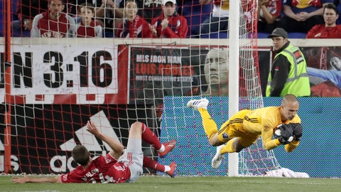 <p>               Montreal Impact goalkeeper Evan Bush, right, dives after collecting the ball, next to New York Red Bulls forward Tom Barlow during the first half of an MLS soccer match Wednesday, May 8, 2019, in Harrison, N.J. (AP Photo/Julio Cortez)             </p>