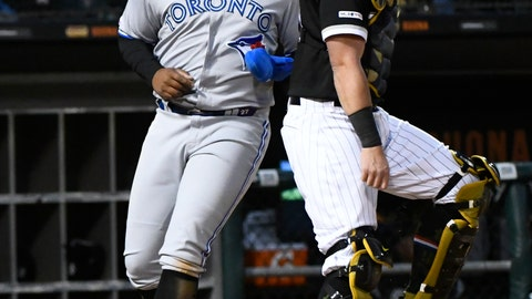 <p>               Toronto Blue Jays' Vladimir Guerrero Jr., left, scores past Chicago White Sox catcher James McCann during the third inning of a baseball game Friday, May 17, 2019, in Chicago. (AP Photo/Matt Marton)             </p>
