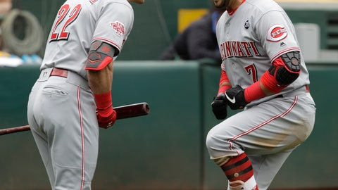 <p>               Cincinnati Reds' Eugenio Suarez, right, celebrates with Derek Dietrich (22) after hitting a home run off Oakland Athletics' Chris Bassitt in the third inning of a baseball game Thursday, May 9, 2019, in Oakland, Calif. (AP Photo/Ben Margot)             </p>