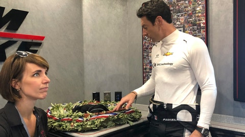 <p>               Indianapolis 500 champion Simon Pagenaud looks at the wreath he won less than a week ago and lamented seeing the leaves and orchids wilting, Friday, May 31, 2019 in Detroit. At the doubleheader in Detroit, the IndyCar points leaders is looking for a way to preserve his coveted prize and is energized to stay on top of the series. (AP Photo/Larry Lage)             </p>