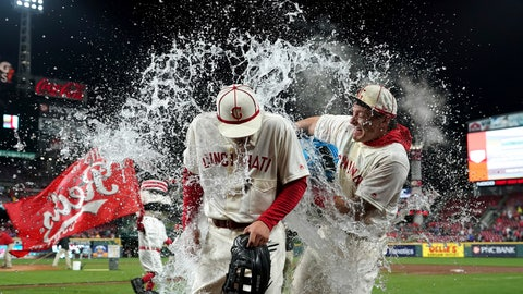 <p>               Cincinnati Reds' Nick Senzel, front, is doused byDerek Dietrich, back, after the team's baseball game against the San Francisco Giants, Saturday, May 4, 2019, in Cincinnati. The Reds won 9-2. (AP Photo/Aaron Doster)             </p>
