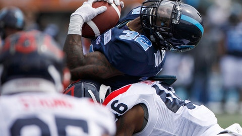 <p>               Toronto Argonauts' James Wilder Jr. (32) is hit by Montreal Alouettes' Paris Taylor during a preseason CFL football game in Toronto, Thursday, May 30, 2019. (Cole Burston/The Canadian Press via AP)             </p>