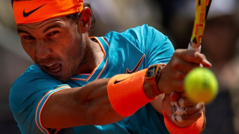 <p>               Rafael Nadal, from Spain, returns the ball to Felix Auger-Aliassime, from Canada, during the Madrid Open tennis tournament in Madrid, Wednesday, May 8, 2019. (AP Photo/Bernat Armangue)             </p>
