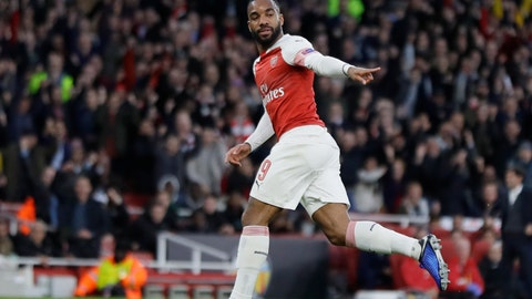 <p>               Arsenal's Alexandre Lacazette celebrates after scoring his side's first goal during the Europa League semifinal first leg soccer match between Arsenal and Valencia at the Emirates stadium in London, Thursday, May 2, 2019. (AP Photo/Kirsty Wigglesworth)             </p>