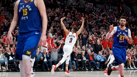 <p>               Portland Trail Blazers guard CJ McCollum, center, reacts after making a three point basket against the Denver Nuggets during overtime of Game 3 of an NBA basketball second-round playoff series Friday, May 3, 2019, in Portland, Ore. (AP Photo/Craig Mitchelldyer)             </p>
