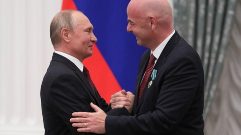 <p>               Russian President Vladimir Putin shakes hands with FIFA President Gianni Infantino during an awarding ceremony in the Kremlin in Moscow, Russia, Thursday, May 23, 2019. Putin awarded FIFA President Gianni Infantino with the Order of Friendship and praised the World Cup that Russia hosted last year as the best ever. (Evgenia Novozhenina/Pool Photo via AP)             </p>