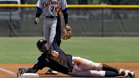 <p>               New York Yankees' Didi Gregorius calls for time out after sliding into third base during the first inning of a Gulf Coast League baseball game Monday, May 20, 2019, in Tampa, Fla. Gregorius is playing for the first time since having Tommy John surgery. (AP Photo/Chris O'Meara)             </p>