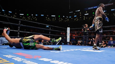 <p>               Deontay Wilder, right, knocks down Dominic Breazeale during the first round of the WBC heavyweight championship boxing match Saturday, May 18, 2019, in New York. Wilder won in the first round. (AP Photo/Frank Franklin II)             </p>