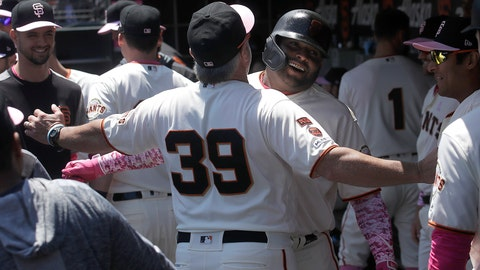 <p>               San Francisco Giants' Pablo Sandoval, center right, is congratulated by assistant hitting coach Rick Schu (39) after hitting a two-run home run against the Cincinnati Reds during the first inning of a baseball game in San Francisco, Sunday, May 12, 2019. (AP Photo/Jeff Chiu)             </p>