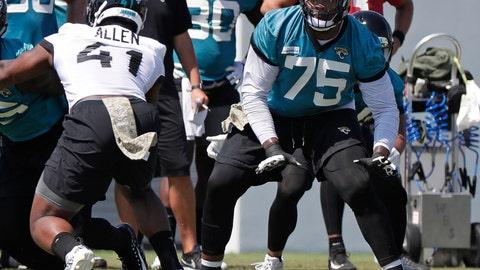 <p>               Jacksonville Jaguars offensive lineman Jawaan Taylor (75) looks to block Jacksonville Jaguars defensive end Josh Allen (41) during an NFL football practice, Tuesday, May 21, 2019, in Jacksonville, Fla. (AP Photo/John Raoux)             </p>
