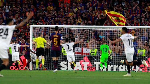 <p>               Valencia players celebrate their team's second goal during the Copa del Rey soccer match final between Valencia CF and FC Barcelona at the Benito Villamarin stadium in Seville, Spain, Saturday. 25, 2019. (AP Photo/Miguel Morenatti)             </p>