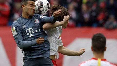 <p>               Bayern midfielder Thiago Alcantara, left, jumps for a header with Leipzig's Marcel Sabitzer during the German Bundesliga soccer match between Leipzig and Bayern Munich at the Red Bull Arena stadium in Leipzig, Germany, Saturday, May 11, 2019. (AP Photo/Michael Probst)             </p>