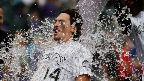 <p>               Colorado Rockies' Tony Wolters is doused by Charlie Blackmon after hitting a sacrifice fly to bring in the winning run off Baltimore Orioles relief pitcher Mychal Givens in the ninth inning of a baseball game, Sunday, May 26, 2019, in Denver. (AP Photo/David Zalubowski)             </p>