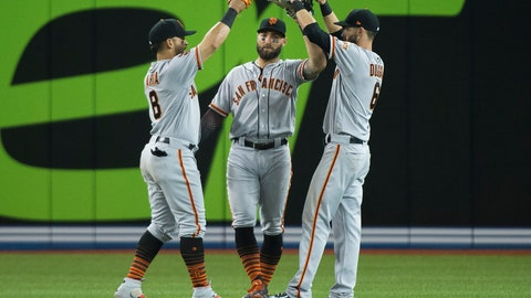 <p>               San Francisco Giants center fielder Kevin Pillar, center, celebrates with left fielder Gerardo Parra, left, and right fielder Steven Duggar, right, after defeating the Toronto Blue Jays 4-0 in an interleague baseball game in Toronto, on Wednesday, April 24, 2019. (Nathan Denette/The Canadian Press via AP)             </p>