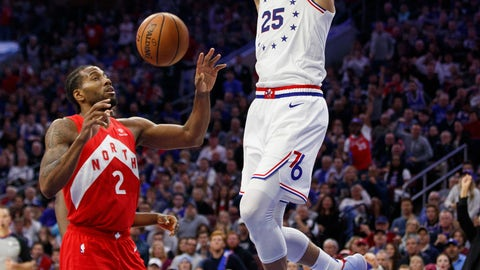 <p>               Philadelphia 76ers' Ben Simmons, right, dunks the ball as Toronto Raptors' Kawhi Leonard, left, looks on during the first half of Game 4 of a second-round NBA basketball playoff series, Sunday, May 5, 2019, in Philadelphia. (AP Photo/Chris Szagola)             </p>