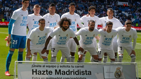 """<p>               Real Madrid team players pose with shirts supporting former club goalkeeper Iker Casillas before a Spanish La Liga soccer match between Real Madrid and Villarreal at the Santiago Bernabeu stadium in Madrid, Spain, Sunday, May 5, 2019. Message reads """"Iker, Everyone with You"""" after Casillas suffered a heart attack while training with Porto. (AP Photo/Paul White)             </p>"""