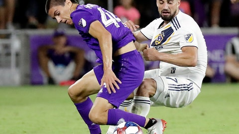 <p>               Orlando City's Joao Moutinho, left, and LA Galaxy's Sebastian Lletget compete for possession of the ball during the second half of an MLS soccer match Friday, May 24, 2019, in Orlando, Fla. (AP Photo/John Raoux)             </p>
