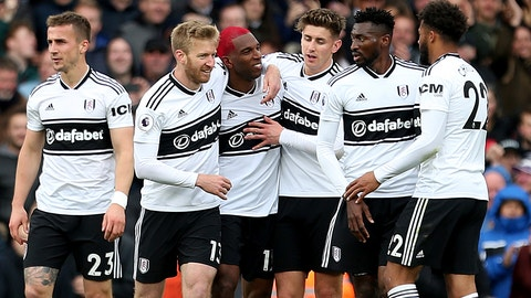 <p>               Fulham's Ryan Babel, center left, celebrates scoring his side's first goal of the game during the English Premier League soccer match between Fulham and Cardiff City at Craven Cottage stadium, London, England. Saturday, April 27, 2019. (Steven Paston/PA via AP)             </p>