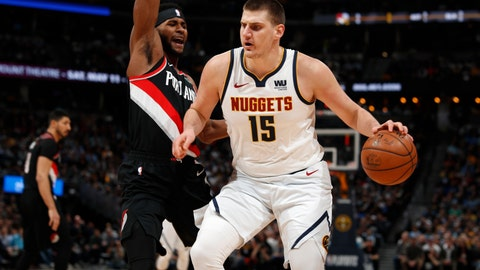 <p>               Denver Nuggets center Nikola Jokic, right, drives to the rim for a basket as Portland Trail Blazers forward Maurice Harkless defends in the first half of Game 5 of an NBA basketball second-round playoff series, Tuesday, May 7, 2019, in Denver. (AP Photo/David Zalubowski)             </p>