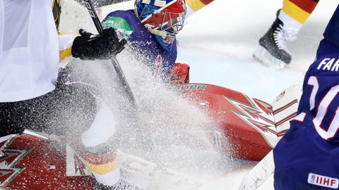<p>               Great Britain's goaltender Ben Bowns, center, makes a save during the Ice Hockey World Championships group A match between Germany and Great Britain at the Steel Arena in Kosice, Slovakia, Saturday, May 11, 2019. (AP Photo/Petr David Josek)             </p>