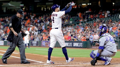 <p>               Houston Astros designated hitter George Springer (4) crosses the plate between umpire Pat Hoberb, left, and Kansas City Royals catcher Martin Maldonado, right, after hitting a home run during the first inning of a baseball game Monday, May 6, 2019, in Houston. (AP Photo/Michael Wyke)             </p>