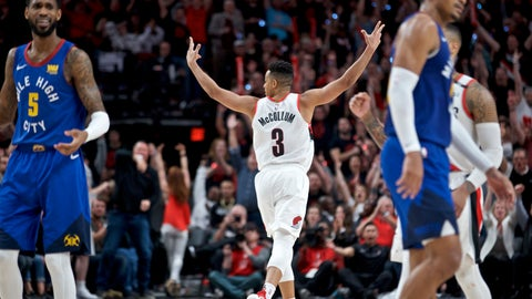 <p>               Portland Trail Blazers guard CJ McCollum, center, reacts after making a three point basket against the Denver Nuggets during the second half of Game 3 of an NBA basketball second-round playoff series Friday, May 3, 2019, in Portland, Ore. (AP Photo/Craig Mitchelldyer)             </p>