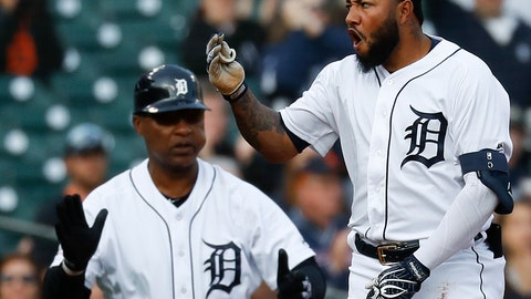 <p>               Detroit Tigers' Ronny Rodriguez, right, reacts to hitting a two-run triple as third base coach Dave Clark watches against the Los Angeles Angels in the first inning of a baseball game in Detroit, Wednesday, May 8, 2019. (AP Photo/Paul Sancya)             </p>
