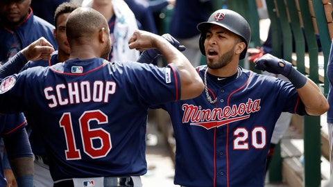 <p>               Minnesota Twins' Eddie Rosario (20) celebrates his solo home run in the dugout with teammate Jonathan Schoop (16) during the eighth inning of the team's baseball game against the Los Angeles Angels on Thursday, May 23, 2019, in Anaheim, Calif. (AP Photo/Marcio Jose Sanchez)             </p>