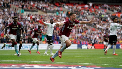 <p>               Aston Villa's John McGinn celebrates scoring his side's second goal of the game during the English Championship Play-off soccer final between Aston Villa and Derby County at Wembley Stadium, London, Monday, May 27, 2019. (Scott Wilson/PA via AP)             </p>