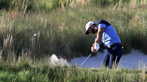 <p>               Dustin Johnson hits out of a bunker on the 18th hole during the third round of the PGA Championship golf tournament, Saturday, May 18, 2019, at Bethpage Black in Farmingdale, N.Y. (AP Photo/Charles Krupa)             </p>