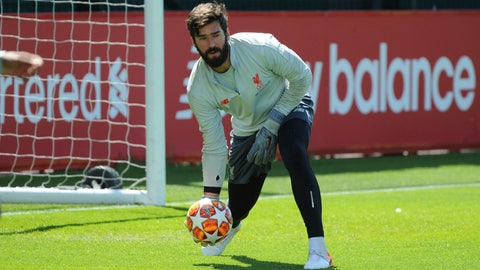 <p>               Liverpool goalkeeper Alisson takes part in a training session at the Liverpool soccer team media open day, in Liverpool, England, Tuesday, May 28, 2019, ahead of their Champions League Final soccer match against Tottenham on Saturday in Madrid. (AP Photo/Rui Vieira)             </p>