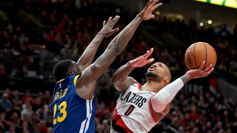 <p>               Portland Trail Blazers guard Damian Lillard, right, shoots over Golden State Warriors forward Draymond Green during the second half of Game 3 of the NBA basketball playoffs Western Conference finals Saturday, May 18, 2019, in Portland, Ore. The Warriors won 110-99. (AP Photo/Craig Mitchelldyer)             </p>