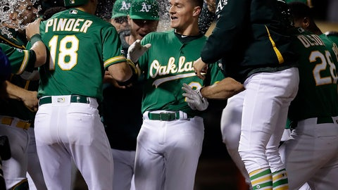 <p>               Oakland Athletics' Matt Chapman, center, celebrates after hitting a game-winning home run against the Cleveland Indians in the 12th inning of a baseball game Friday, May 10, 2019, in Oakland, Calif. (AP Photo/Ben Margot)             </p>