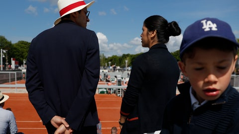 <p>               A host and hostess wait for spectators to arrive to watch second round matches of the French Open tennis tournament at the Roland Garros stadium in Paris, Wednesday, May 29, 2019. (AP Photo/Pavel Golovkin)             </p>