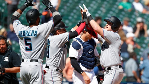 <p>               Miami Marlins' Garrett Cooper, right, celebrates with teammates after hitting a grand slam in the ninth inning of a baseball game against the Detroit Tigers in Detroit, Thursday, May 23, 2019. (AP Photo/Paul Sancya)             </p>