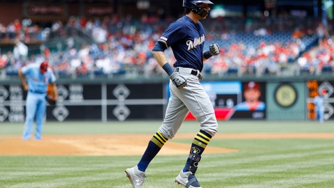 <p>               Milwaukee Brewers' Christian Yelich, right, rounds the bases after hitting a home run off Philadelphia Phillies starting pitcher Zach Eflin, left, during the first inning of a baseball game, Thursday, May 16, 2019, in Philadelphia. (AP Photo/Matt Slocum)             </p>