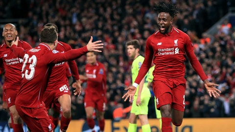 <p>               Liverpool's Divock Origi, right, celebrates scoring his side's fourth goal of the game during the Champions League Semi Final, second leg soccer match between Liverpool and Barcelona at Anfield, Liverpool, England, Tuesday, May 7, 2019. (Peter Byrne/PA via AP)             </p>