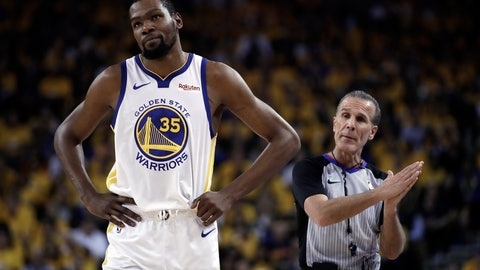 <p>               Golden State Warriors' Kevin Durant, left, walks away from referee Ken Mauer during the first half of Game 5 of the team's second-round NBA basketball playoff series against the Houston Rockets on  Wednesday, May 8, 2019, in Oakland, Calif. (AP Photo/Ben Margot)             </p>