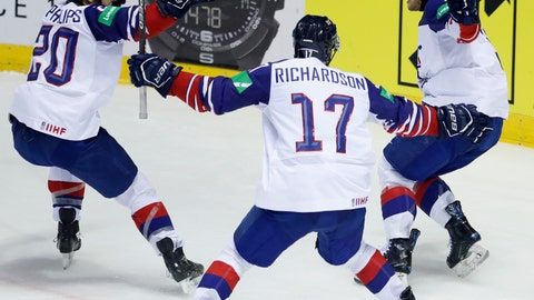 <p>               Great Britain's Ben Davies, right, celebrates with teammates Mark Richardson, center, and Jonathan Phillips, left, after scoring his sides winning goal during the Ice Hockey World Championships group A match between France and Great Britain at the Steel Arena in Kosice, Slovakia, Monday, May 20, 2019. (AP Photo/Petr David Josek)             </p>