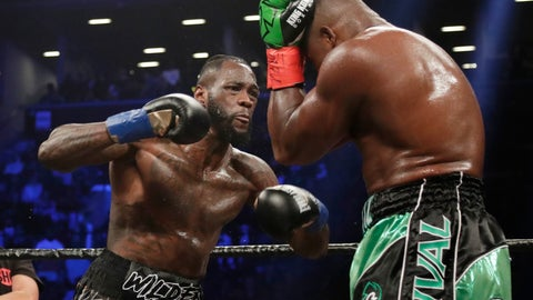 <p>               FILE - In this March 3, 2018, file photo, Deontay Wilder, left, fights Luis Ortiz during the third round of the WBC heavyweight championship bout in New York. Wilder won in the 10th round.Whatever disappointment Wilder may have had in not fighting Anthony Joshua or Tyson Fury next is gone. The heavyweight champion can't wait to get in the ring with Dominic Breazeale. (AP Photo/Frank Franklin II, File)             </p>