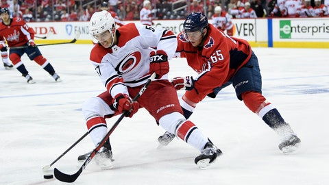 <p>               Carolina Hurricanes defenseman Trevor van Riemsdyk (57) skates with the puck against Washington Capitals left wing Andre Burakovsky (65) during the second period of Game 5 of an NHL hockey first-round playoff series, Saturday, April 20, 2019, in Washington. (AP Photo/Nick Wass)             </p>