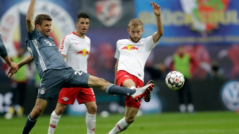 <p>               Bayern forward Thomas Mueller, left, vie for the ball with Leipzig's Konrad Laimer during the German Bundesliga soccer match between Leipzig and Bayern Munich at the Red Bull Arena stadium in Leipzig, Germany, Saturday, May 11, 2019. (AP Photo/Michael Probst)             </p>