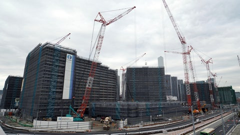 <p>               In this Feb. 12, 2019, photo, cranes continue to work at the construction site of the Olympic Village for the 2020 Tokyo Olympics in Tokyo. An IOC inspection team began a routine tour of venues being built for the Tokyo Olympics on Tuesday, May 21, 2019, just days after an international labor union federation derided difficult working conditions at some sites. (AP Photo/Eugene Hoshiko)             </p>