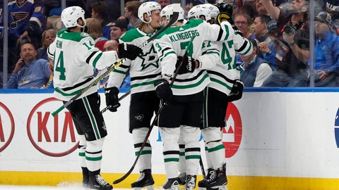 <p>               Dallas Stars players Jamie Benn (14), John Klingberg (3), of Sweden, and Alexander Radulov (47), of Russia, celebrate after a goal by Esa Lindell against the St. Louis Blues during the second period in Game 5 of an NHL second-round hockey playoff series Friday, May 3, 2019, in St. Louis. (AP Photo/Jeff Roberson)             </p>