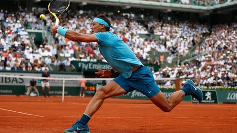 <p>               FILE - In this June 10, 2018, file photo, Spain's Rafael Nadal returns the ball to Austria's Dominic Thiem during the men's final match of the French Open tennis tournament at the Roland Garros stadium in Paris. (AP Photo/Thibault Camus, File)             </p>