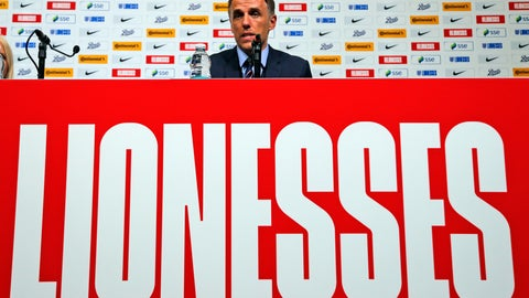 <p>               England women's soccer head coach Phil Neville speaks about his 2019 FIFA World Cup squad in a media conference at Wembley stadium in London, Wednesday, May 8, 2019. (AP Photo/Frank Augstein)             </p>